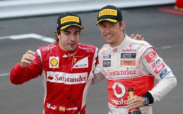 Fernando Alonso y Jenson Button tras el GP de Mónaco 2011