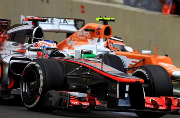 Button y Hulkenberg. GP Brasil 2012