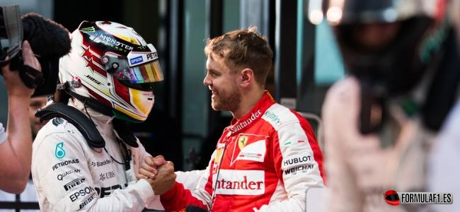 MELBOURNE, AUSTRALIA - MARCH 15:  Sebastian Vettel of Ferrari and Germany congratulates Lewis Hamilton of Mercedes and Great Britain during the Australian Formula One Grand Prix at Albert Park on March 15, 2015 in Melbourne, Australia.  (Photo by Peter J Fox/Getty Images)